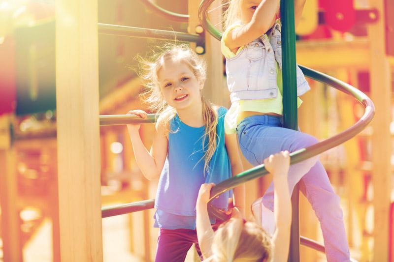 group-of-happy-kids-on-children-playground-P57YL4N.jpg